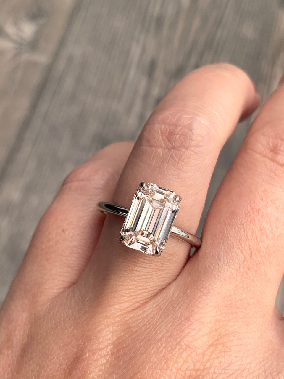 Frank darling custom 5 carat diamond ring set in platinum with an emerald cut diamond
