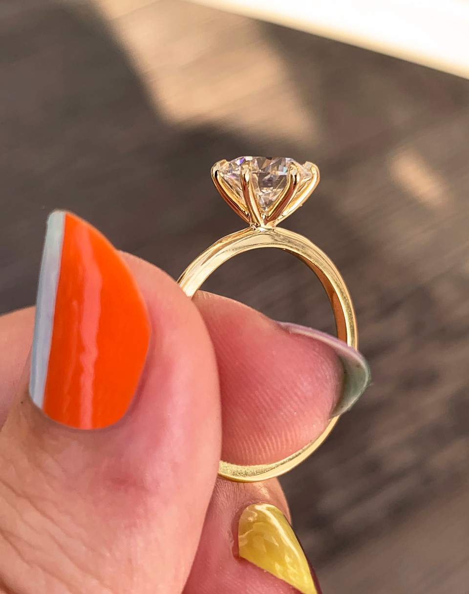 six prong yellow gold solitaire modern engagement ring, tiffany style setting, set with a lab grown diamond