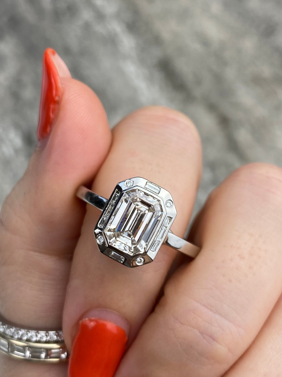 Frank Darling custom diamond engagement ring with a baguette and round halo