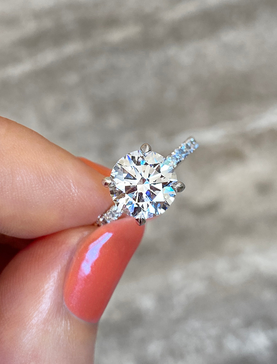 Four prong platinum solitaire engagement ring with 3/4 pave band