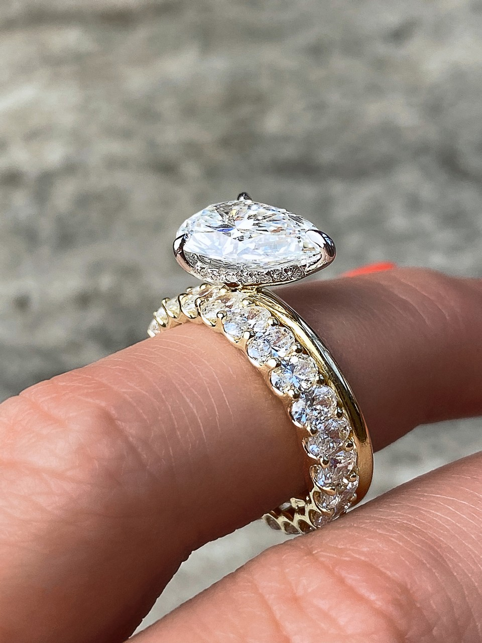 custom frank darling pear solitaire with north south oval eternity band